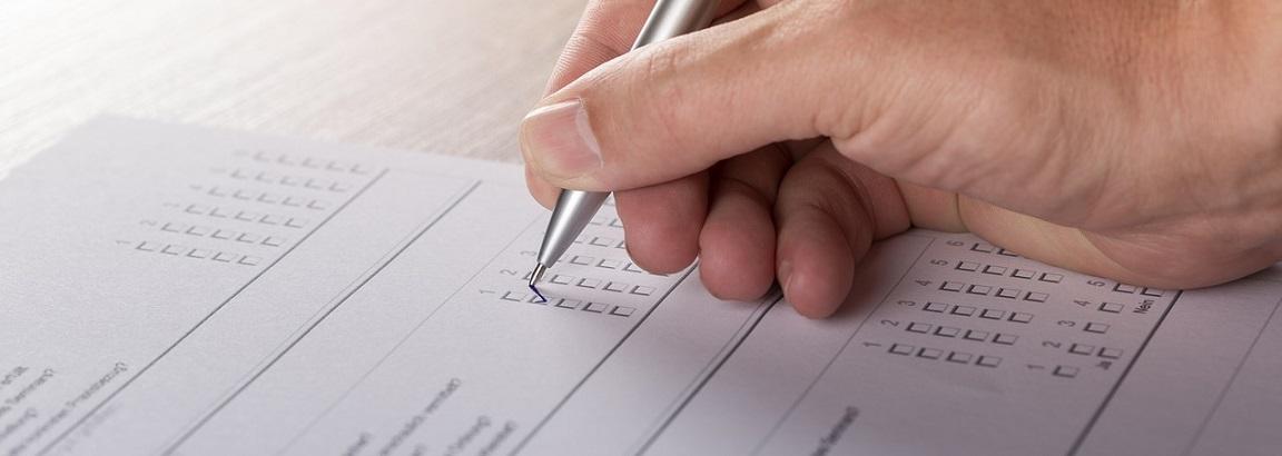 Person ticking a survey